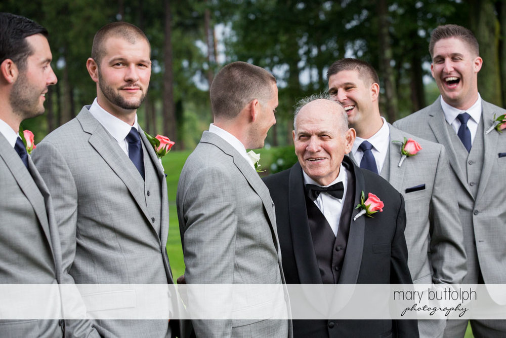 Groom accompanied by his groomsmen talks to the bride's father at Turning Stone Resort Casino Wedding