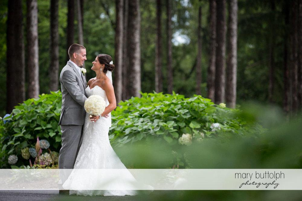 Couple pose in the garden at Turning Stone Resort Casino Wedding