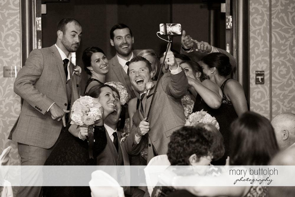 Groomsmen and bridesmaids take a selfie at Turning Stone Resort Casino Wedding