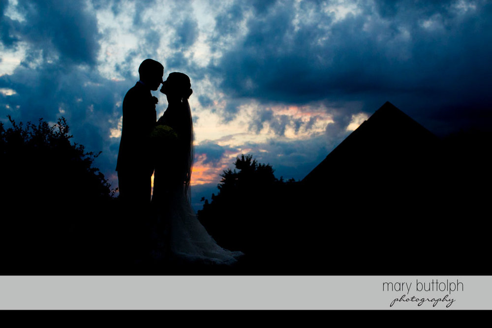 Couple kiss in the dark at Turning Stone Resort Casino Wedding