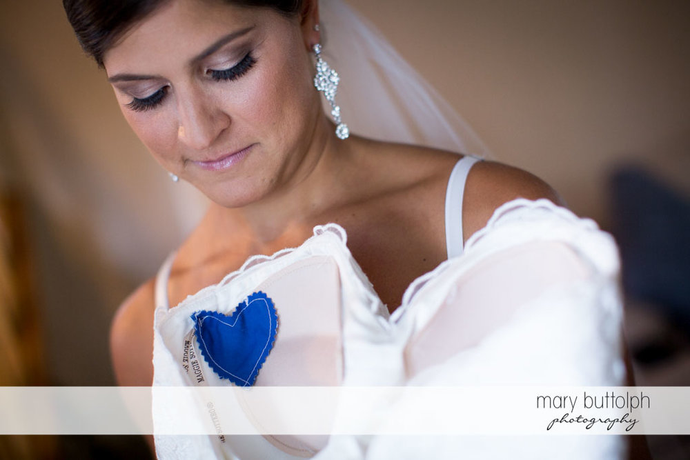 A blue hearts turns up on the bride's wedding dress at Turning Stone Resort Casino Wedding