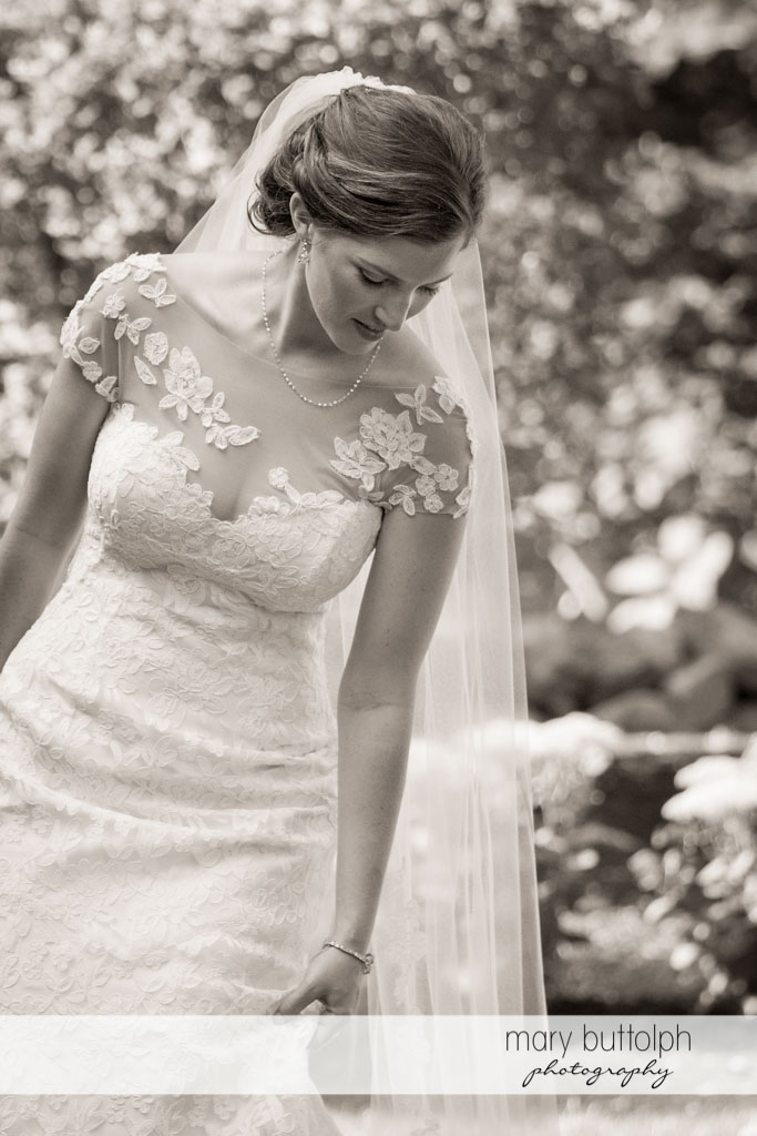 Bride in dramatic black and white shot at Skaneateles Country Club Wedding