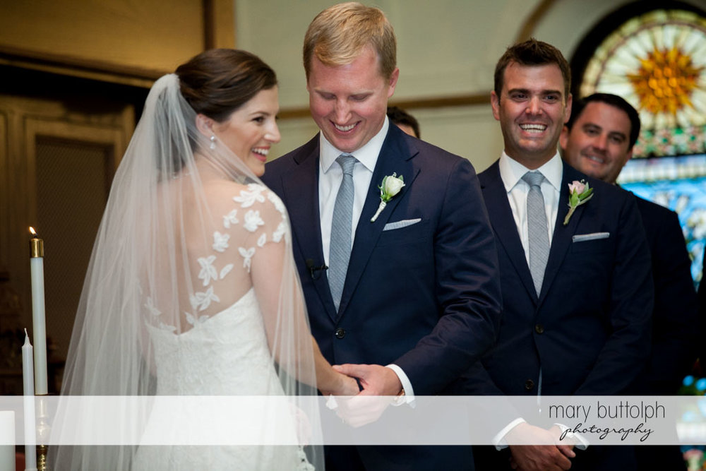 Couple share a light moment during the wedding ceremony at Skaneateles Country Club Wedding