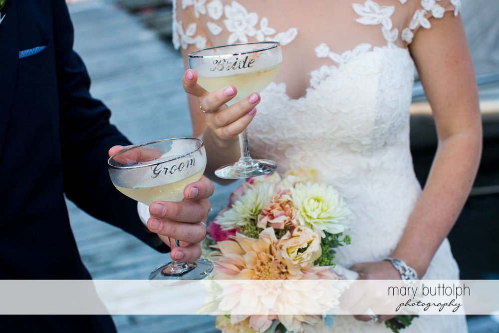 Couple use personalized wine glasses at Skaneateles Country Club Wedding