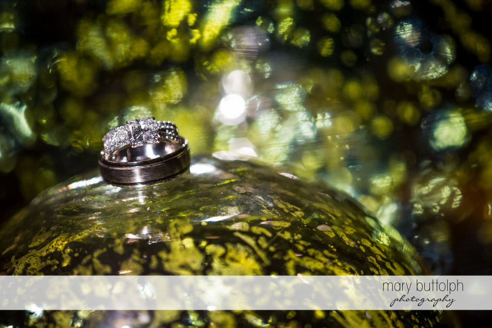 Close up of couple's wedding rings at Skaneateles Country Club Wedding