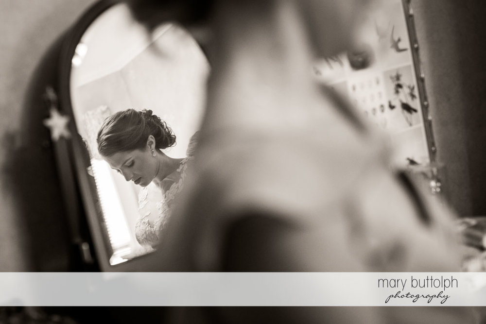 Bride's reflection appears in the mirror at Skaneateles Country Club Wedding