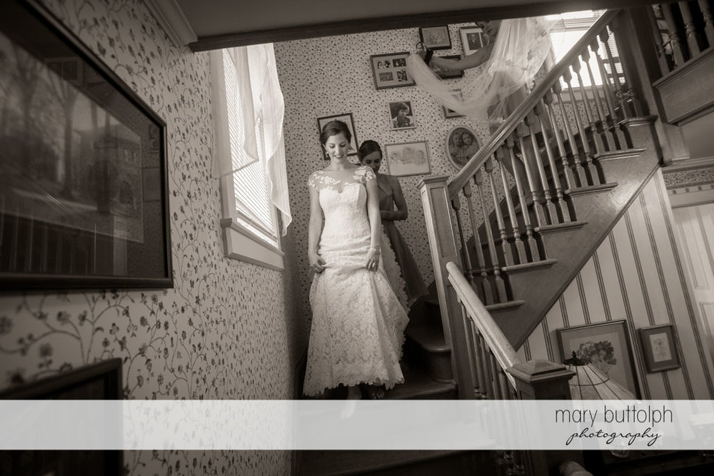 Bride goes downstairs to meet the groom at Skaneateles Country Club Wedding