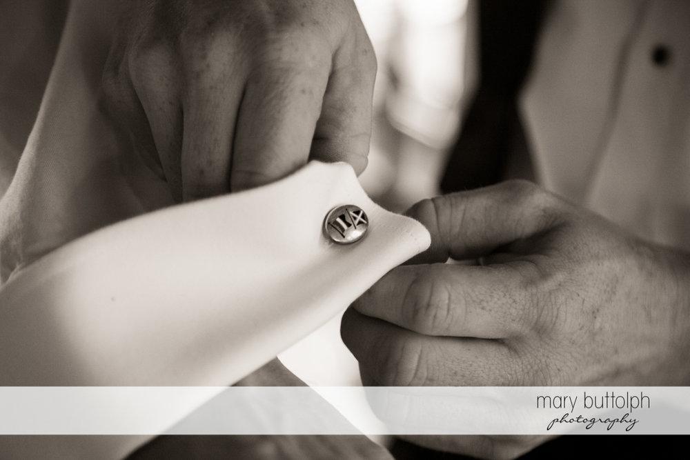 Man fixes his cuff links at the Brewster Inn Wedding