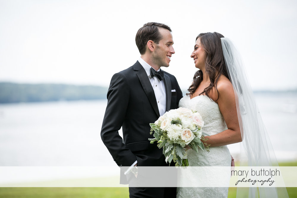 Couple face each other near the lake at the Brewster Inn Wedding