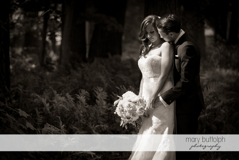 Couple share a quiet moment in the woods at the Brewster Inn Wedding