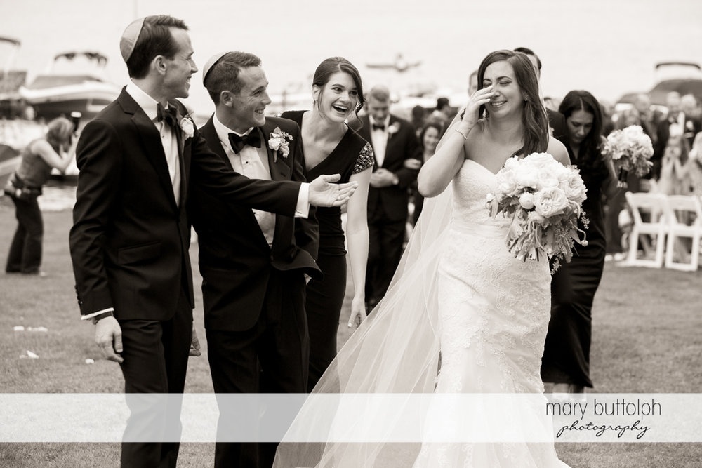 Bride gets teary-eyed in front of the groom and guests at the Brewster Inn Wedding