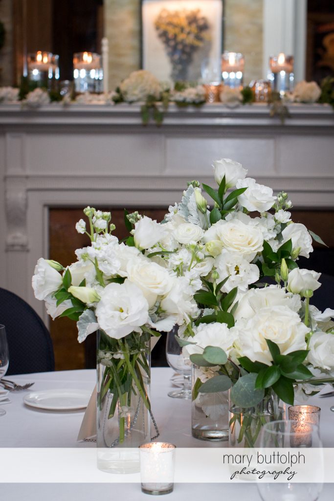 Bouquets add a touch of class to the tables at the Brewster Inn Wedding