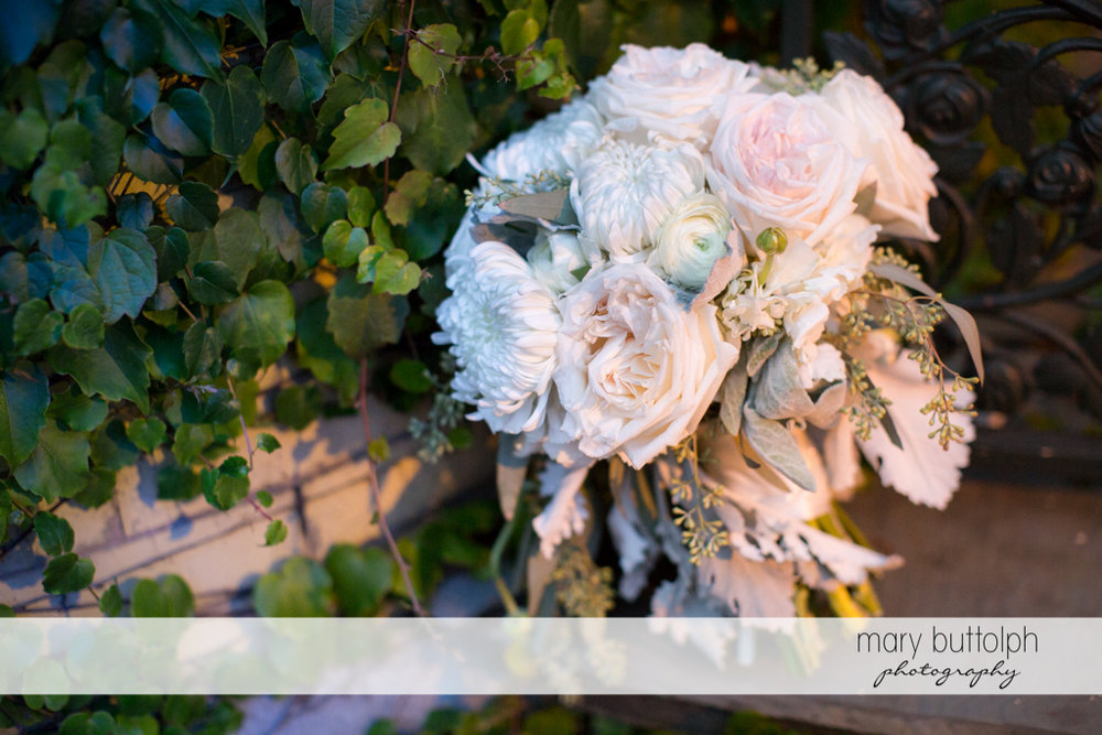 Flowers add beauty to the leaves in the garden at the Brewster Inn Wedding
