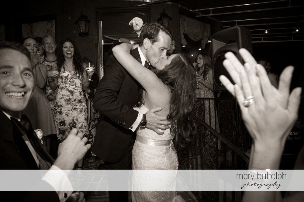 Couple kiss on the dance floor to the delight of guests at the Brewster Inn Wedding
