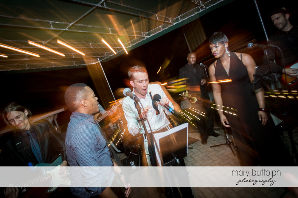 Groom becomes the center of attraction as he raps for guests at the Brewster Inn Wedding