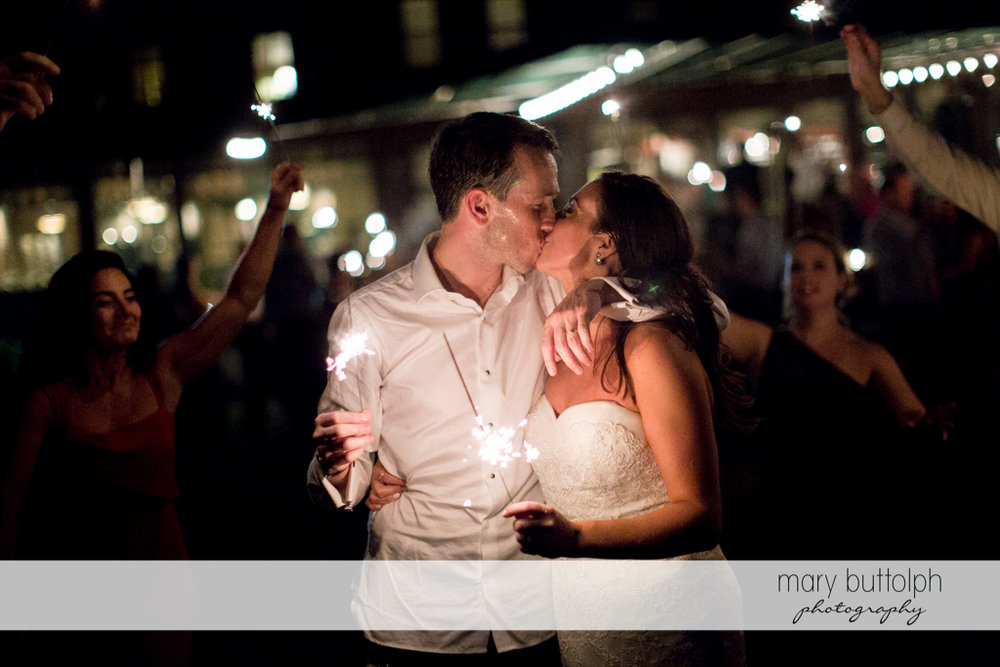 Couple hold sparklers as they kiss at the Brewster Inn Wedding