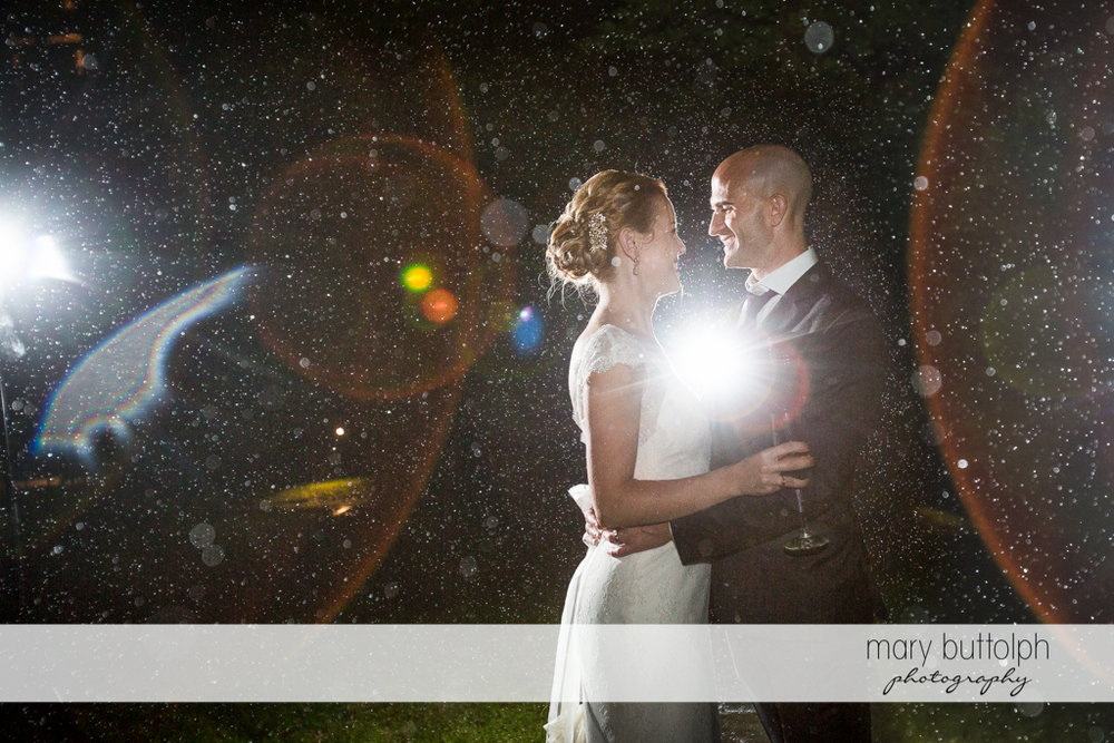 The rain can't stop this couple from smiling in the garden at the Inns of Aurora Wedding