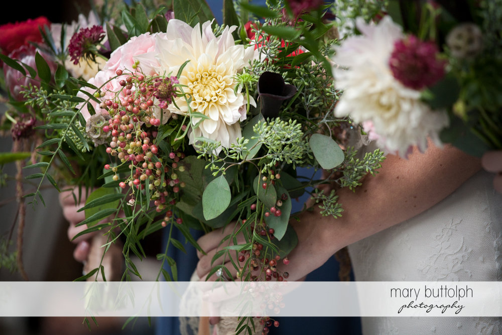 Close up shot of bouquets held by the bride and bridesmaids at the Inns of Aurora Wedding