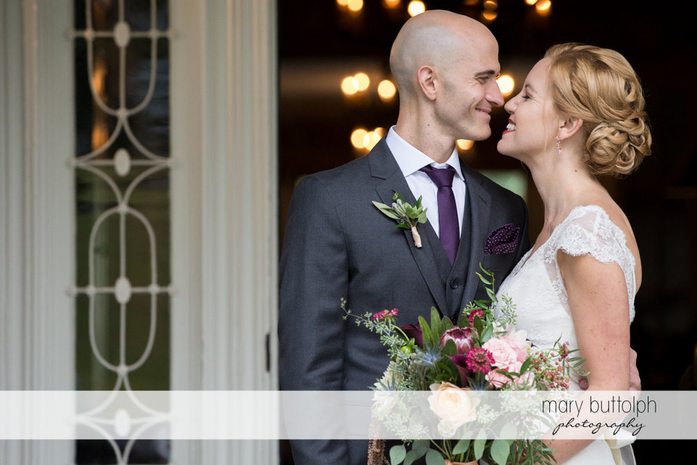 Couple rub noses at the Inns of Aurora Wedding