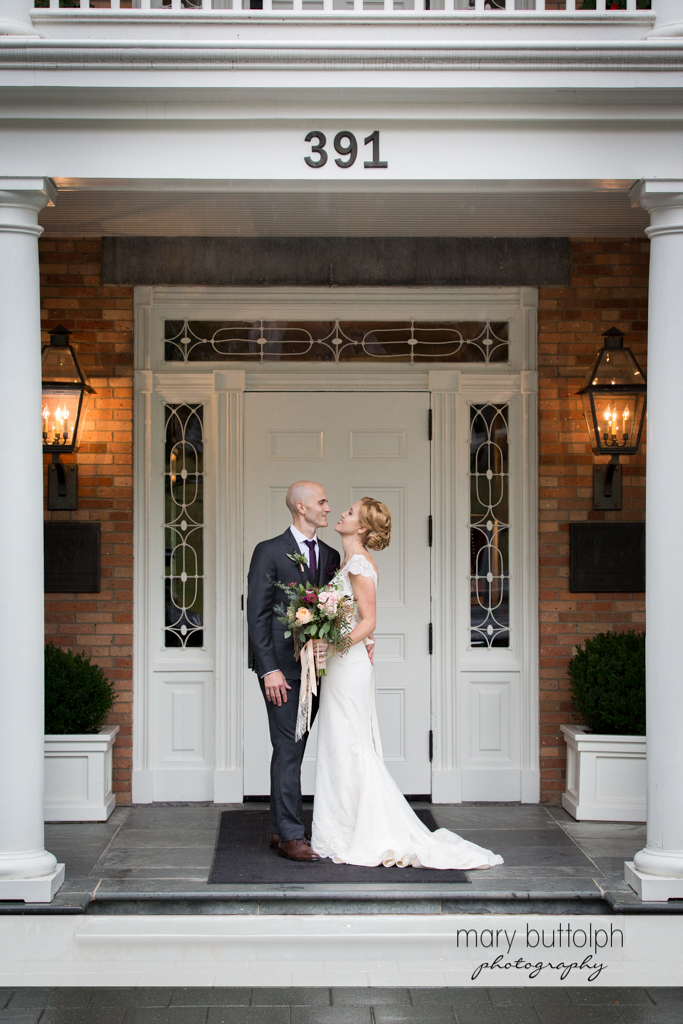 Couple stand in front of a door at the Inns of Aurora Wedding