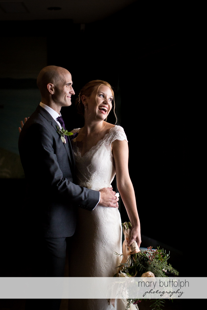 Couple smile for the camera at the Inns of Aurora Wedding