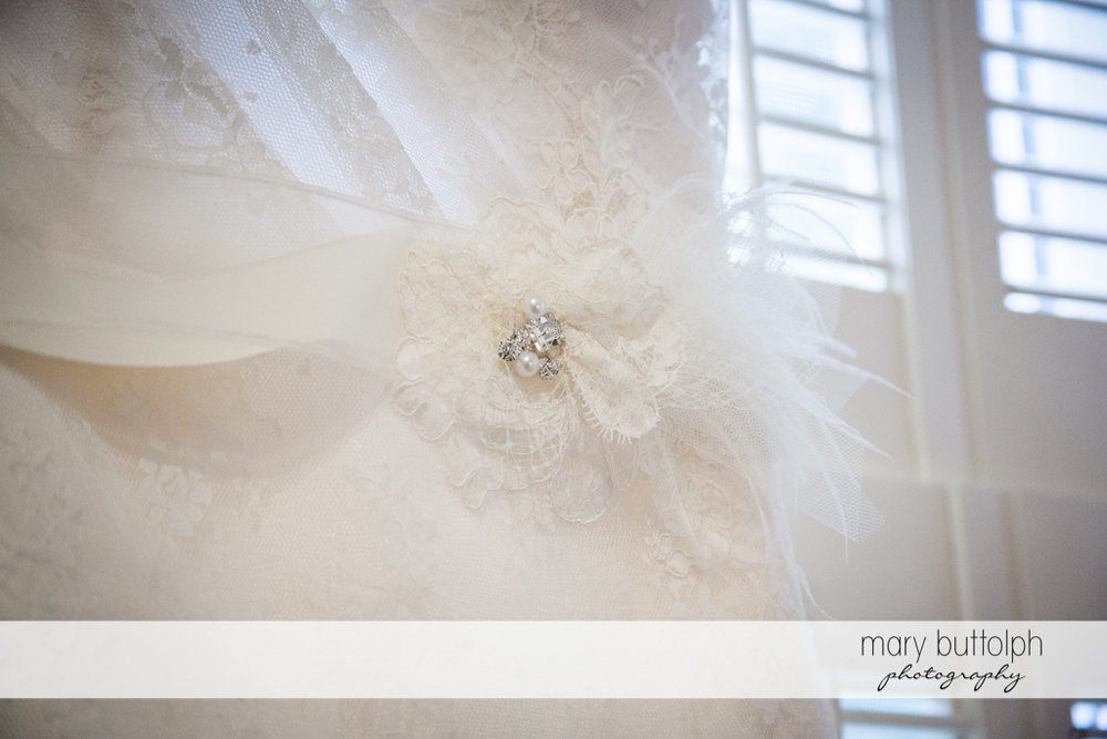 Brooch adds class to the bride's wedding dress at the Inns of Aurora Wedding