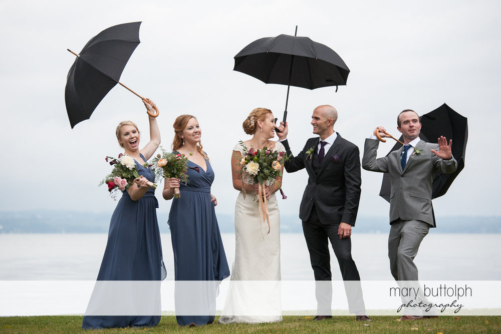 The wedding party in a candid pose near the lake at the Inns of Aurora Wedding