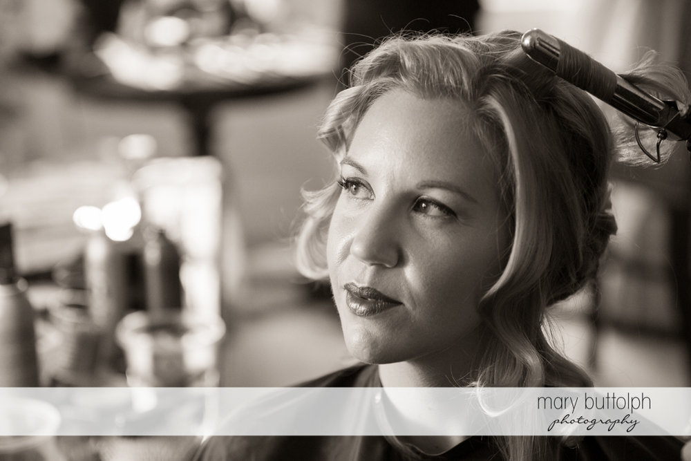 Close up shot of the bride with hair curler at the Inns of Aurora Wedding