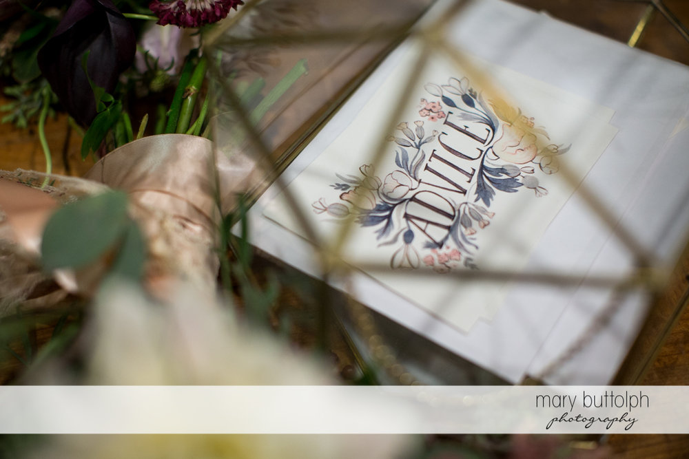 One of the cards with a bouquet at the Inns of Aurora Wedding