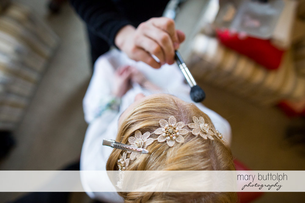 Overhead shot of the bride getting a makeover at the Inns of Aurora Wedding