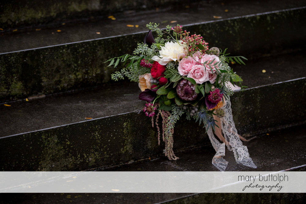 Colorful bouquet on the stone steps at the Inns of Aurora Wedding