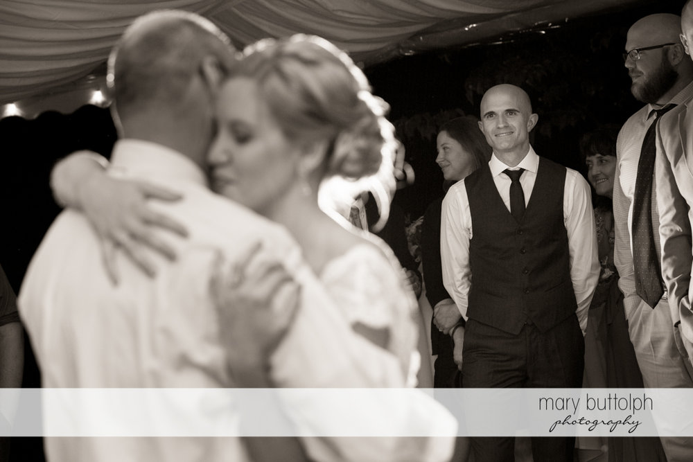 Groom looks at the bride dancing with her father at the Inns of Aurora Wedding