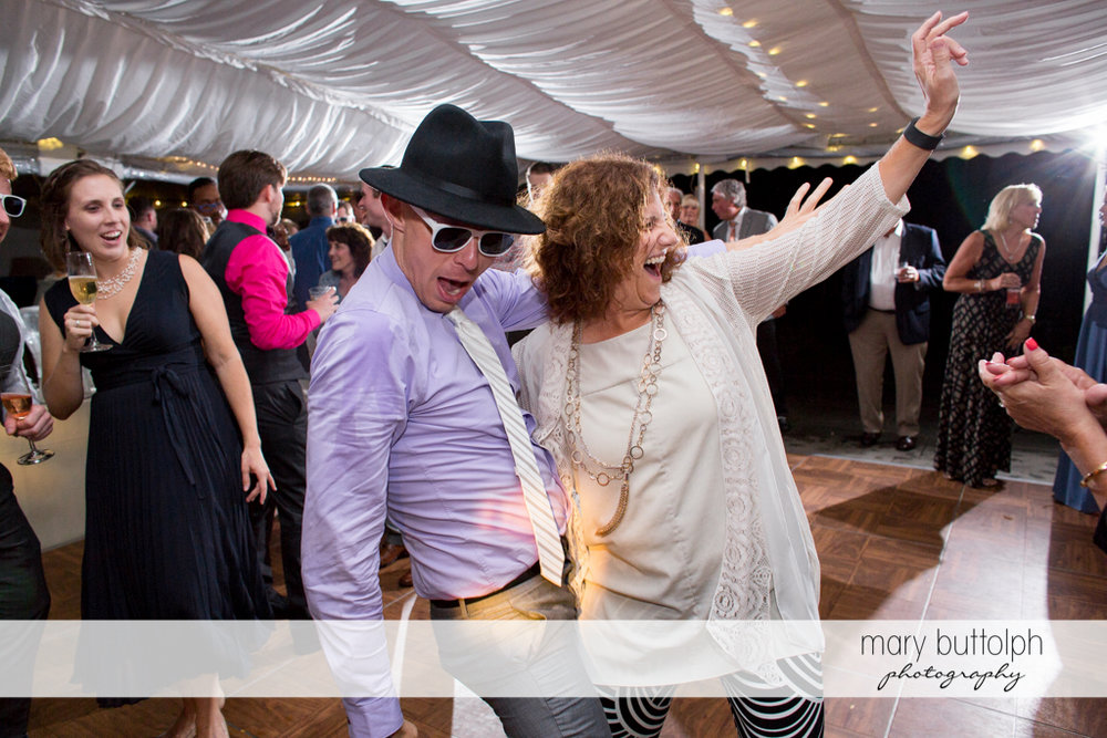 Guests show their moves on the dance floor at the Inns of Aurora Wedding