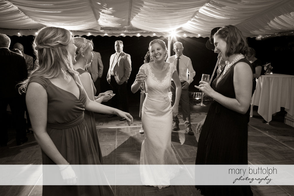 Bride having a good time with guests at the Inns of Aurora Wedding