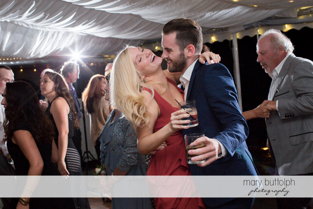 Guests drink while dancing at the Inns of Aurora Wedding