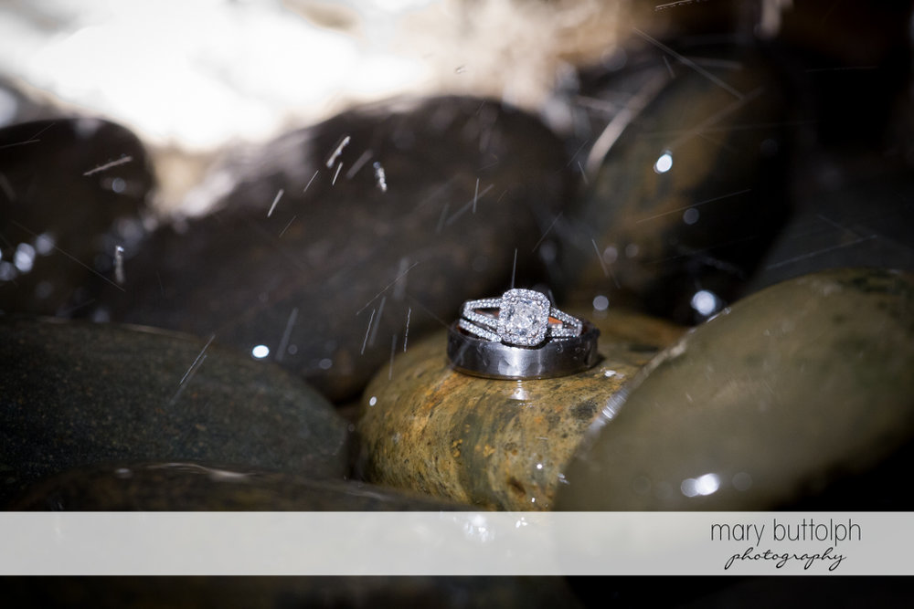 Bride's wedding ring on top of stones at the Inns of Aurora Wedding