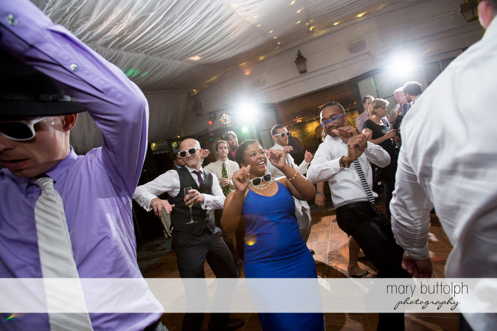 Groom dances with guests at the Inns of Aurora Wedding