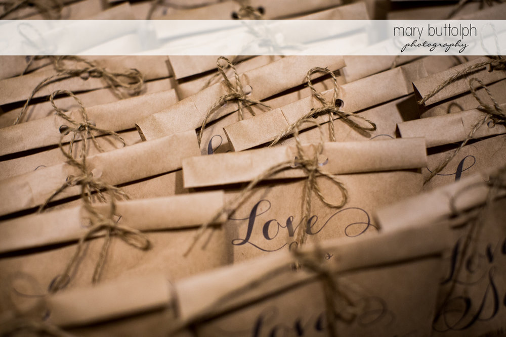 Close up shot of the sweet wedding treats for guests at the Inns of Aurora Wedding