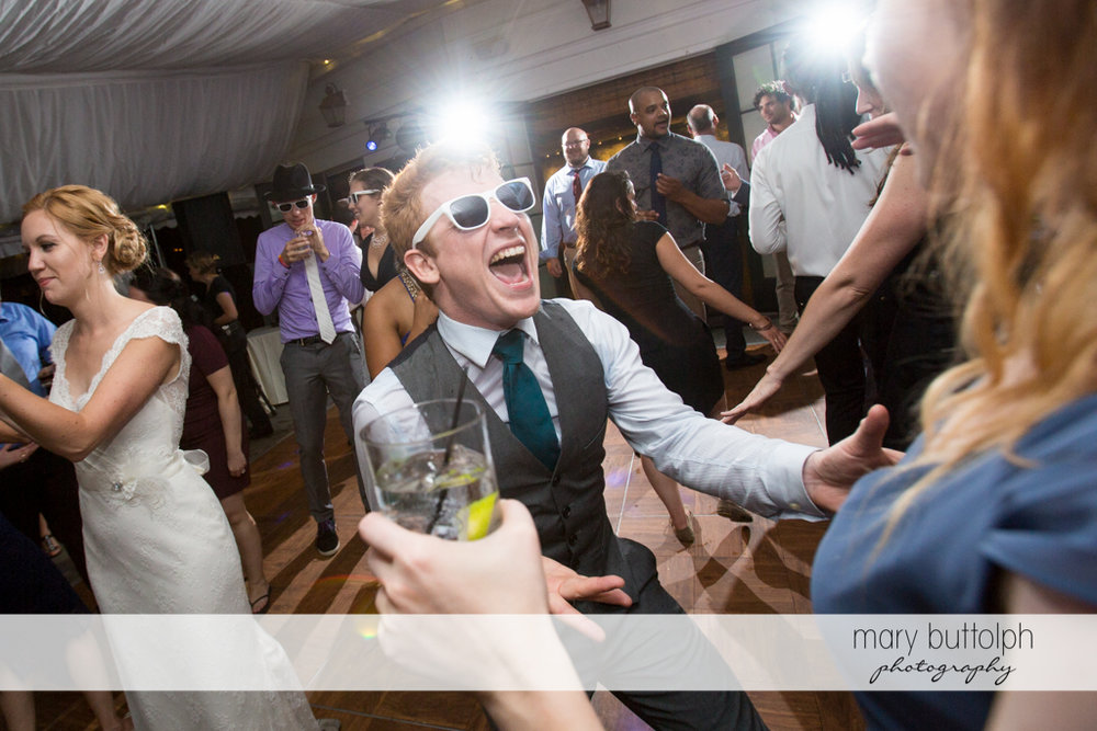 Guests having fun on the dance floor at the Inns of Aurora Wedding