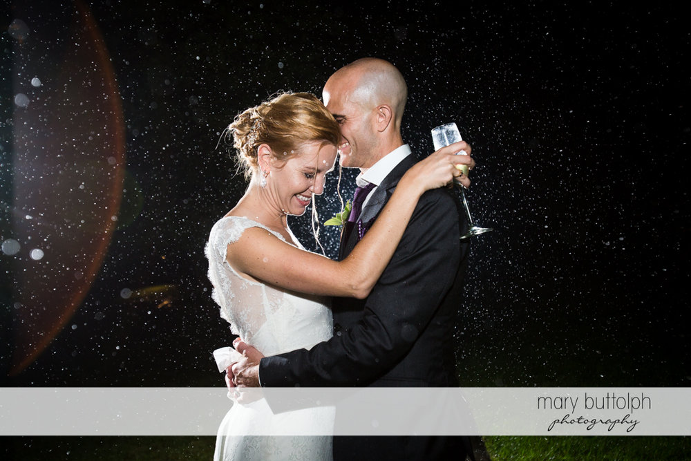 Couple laugh in the rain at the Inns of Aurora Wedding