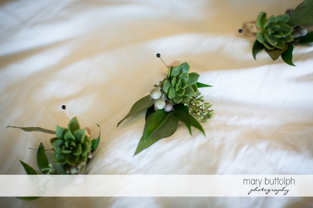 Bride's wedding dress is decorated with flowers at the Inns of Aurora Wedding