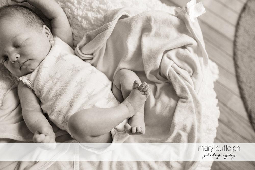 Baby girl sleeps peacefully in the crib at Skaneateles Newborn