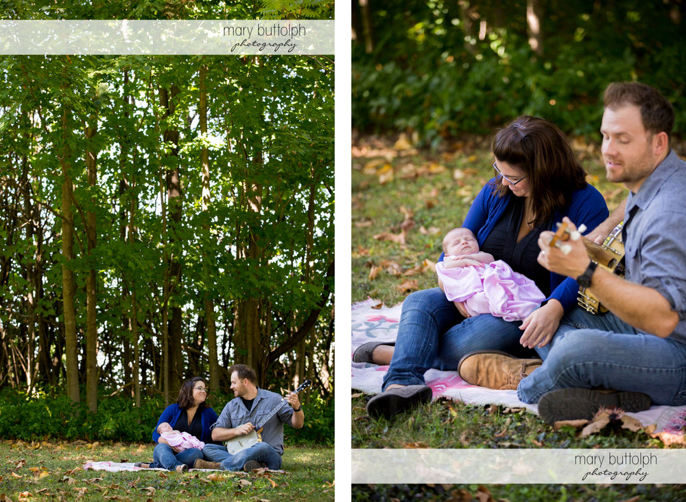 Couple entertain baby with a little music in the garden at Skaneateles Newborn