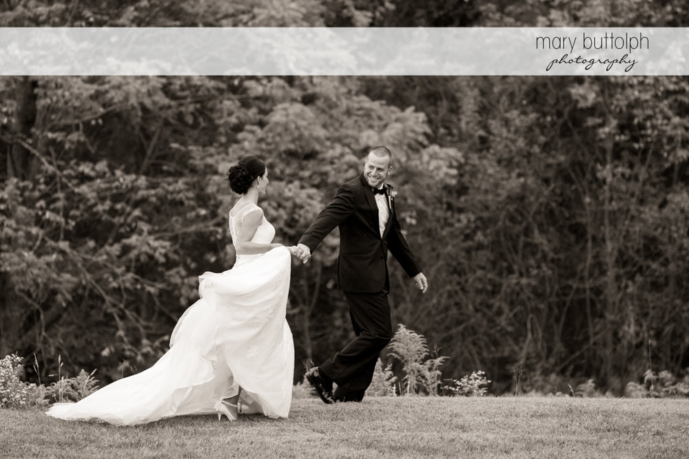 Couple stroll in the woods at Anyela's Vineyards Wedding