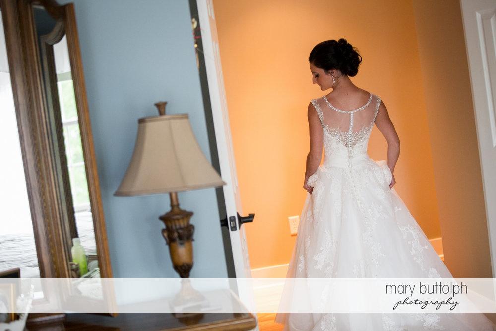 Bride leaves her room at Anyela's Vineyards Wedding