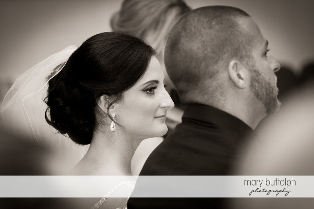 Back view of the couple during the wedding ceremony at Anyela's Vineyards Wedding
