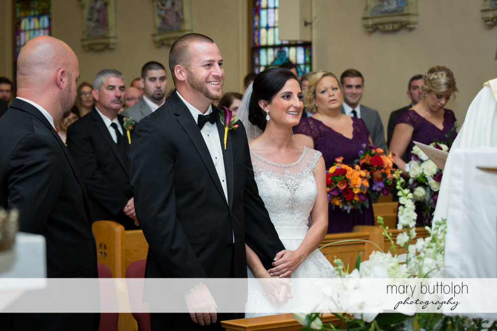 Couple face the priest at Anyela's Vineyards Wedding