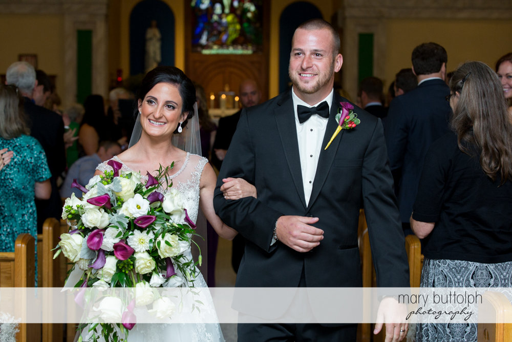 Couple leave church after the wedding at Anyela's Vineyards Wedding