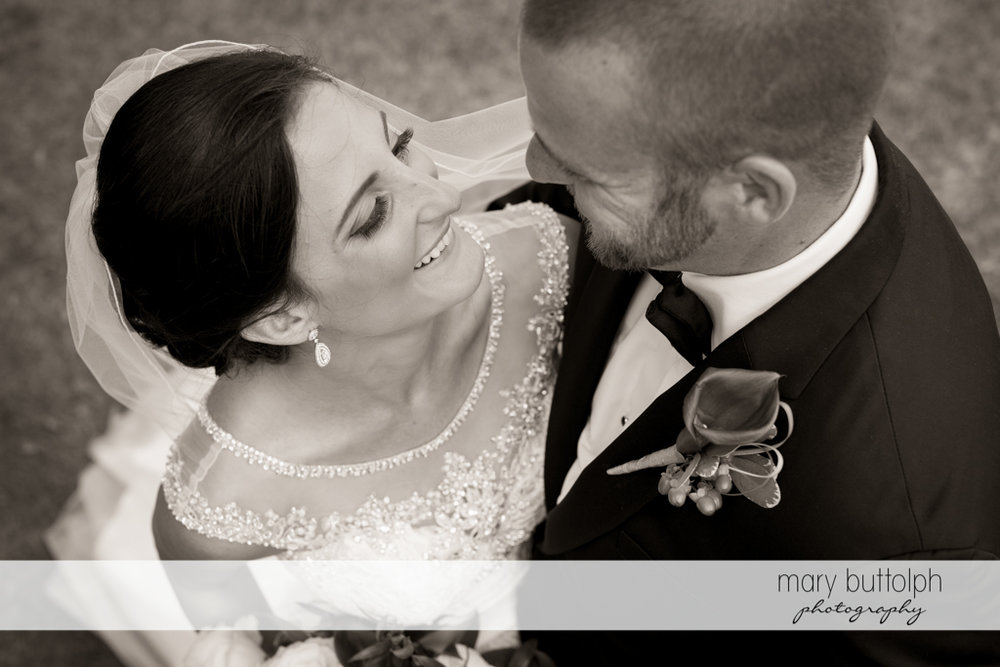 Couple share a happy moment at Anyela's Vineyards Wedding