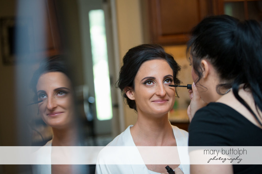 Bride gets a makeover from a friend at Anyela's Vineyards Wedding